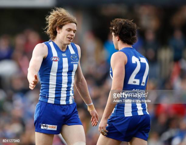 Ben Brown of the Kangaroos celebrates a goal with Taylor Garner of the Kangaroos during the 2017 AFL round 19 match between the North Melbourne...