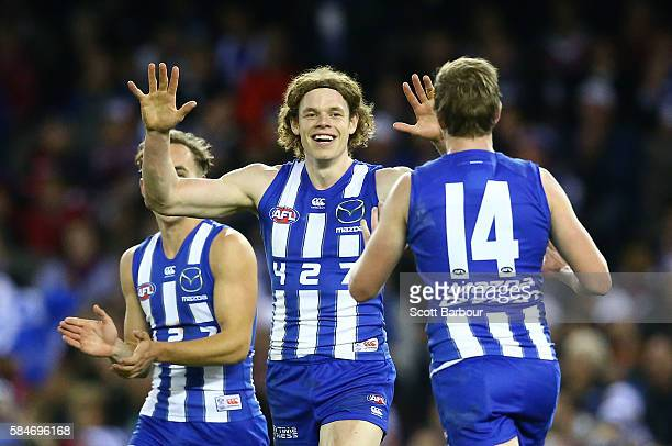 Ben Brown of the Kangaroos celebrates after kicking a goal during the round 19 AFL match between the North Melbourne Kangaroos and the St Kilda...