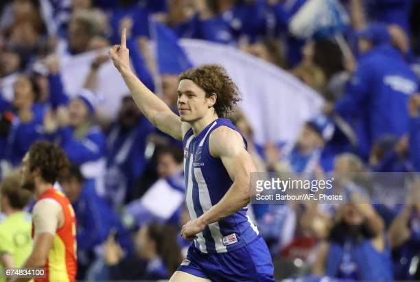 Ben Brown of the Kangaroos celebrates after kicking a goal during the round six AFL match between the North Melbourne Kangaroos and the Gold Coast...