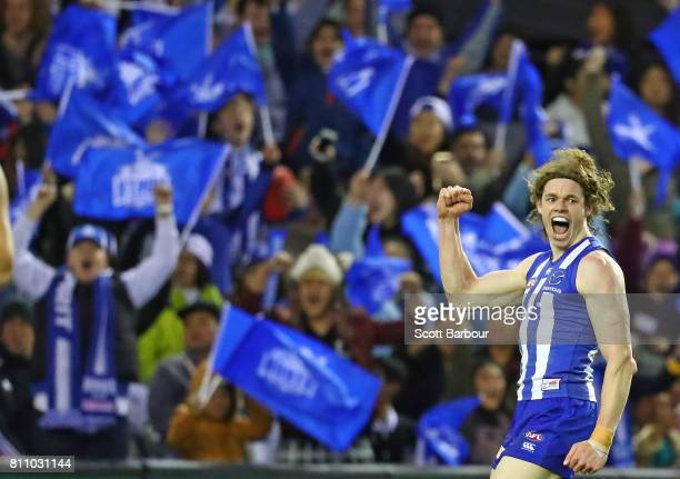 Ben Brown of the Kangaroos celebrates after kicking a goal during the round 16 AFL match between the North Melbourne Kangaroos and the Fremantle...