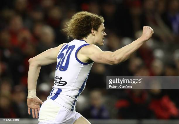 Ben Brown of the Kangaroos celebrates after scoring a goal during the round 18 AFL match between the Essendon Bombers and the North Melbourne...