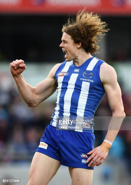 Ben Brown of the Kangaroos celebrates kicking a goal during the round 19 AFL match between the North Melbourne Kangaroos and the Melbourne Demons at...