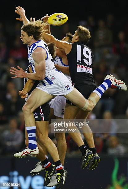Ben Brown of the Kangaroos competes for the ball against Sam Gilbert of the Saints during the round seven AFL match between the St Kilda Saints and...