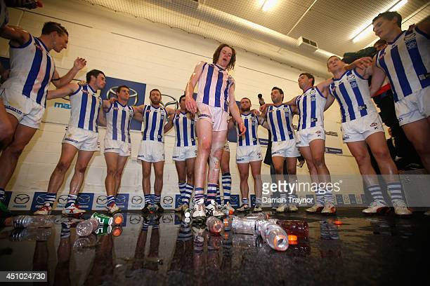 Ben Brown of the Kangaroos is showered by team mates after the round 14 AFL match between the Melbourne Demons and the North Melbourne Kangaroos at...