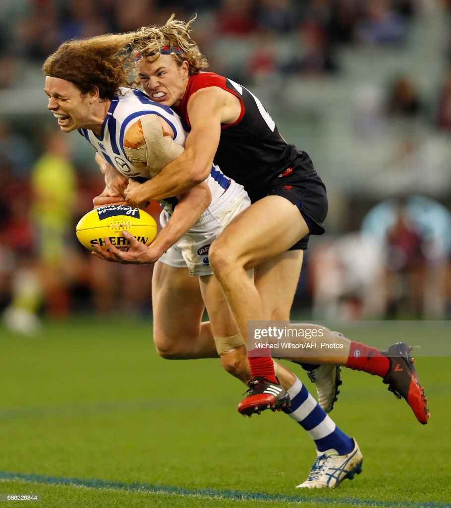 Ben Brown of the Kangaroos is tackled by Jayden Hunt of the Demons during the 2017 AFL round 09 match between the Melbourne Demons and the North Melbourne Kangaroos at the Melbourne Cricket Ground on May 21, 2017 in Melbourne, Australia.