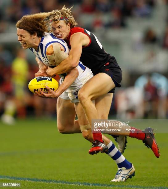 Ben Brown of the Kangaroos is tackled by Jayden Hunt of the Demons during the 2017 AFL round 09 match between the Melbourne Demons and the North...