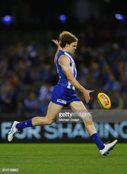 Ben Brown of the Kangaroos kicks the ball for a goal during the round six AFL match between the North Melbourne Kangaroos and the Gold Coast Suns at...