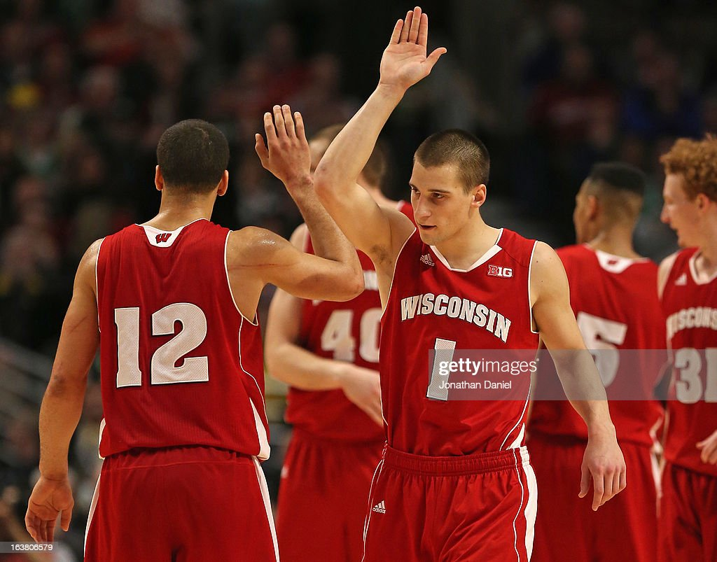 Ben Brust #1 of the Wisconsin Badgers celebrates with teammate Traevon Jackson #12 during a semifinal game of the Big Ten Basketball Tournament against the Indiana Hoosiers at the United Center on March 16, 2013 in Chicago, Illinois. Wisconsin defeats Indiana 68-56.