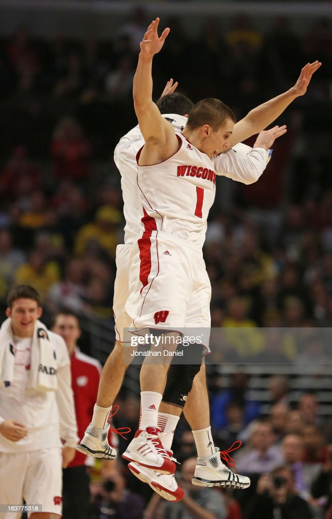 Ben Brust #1 of the Wisconsin Badgers celebrates with teammates near the end of a game against the Michigan Wolverines during a quarterfinal game of the Big Ten Basketball Tournament at the United Center on March 15, 2013 in Chicago, Illinois. Wisconsin defeated Michigan 68-59.