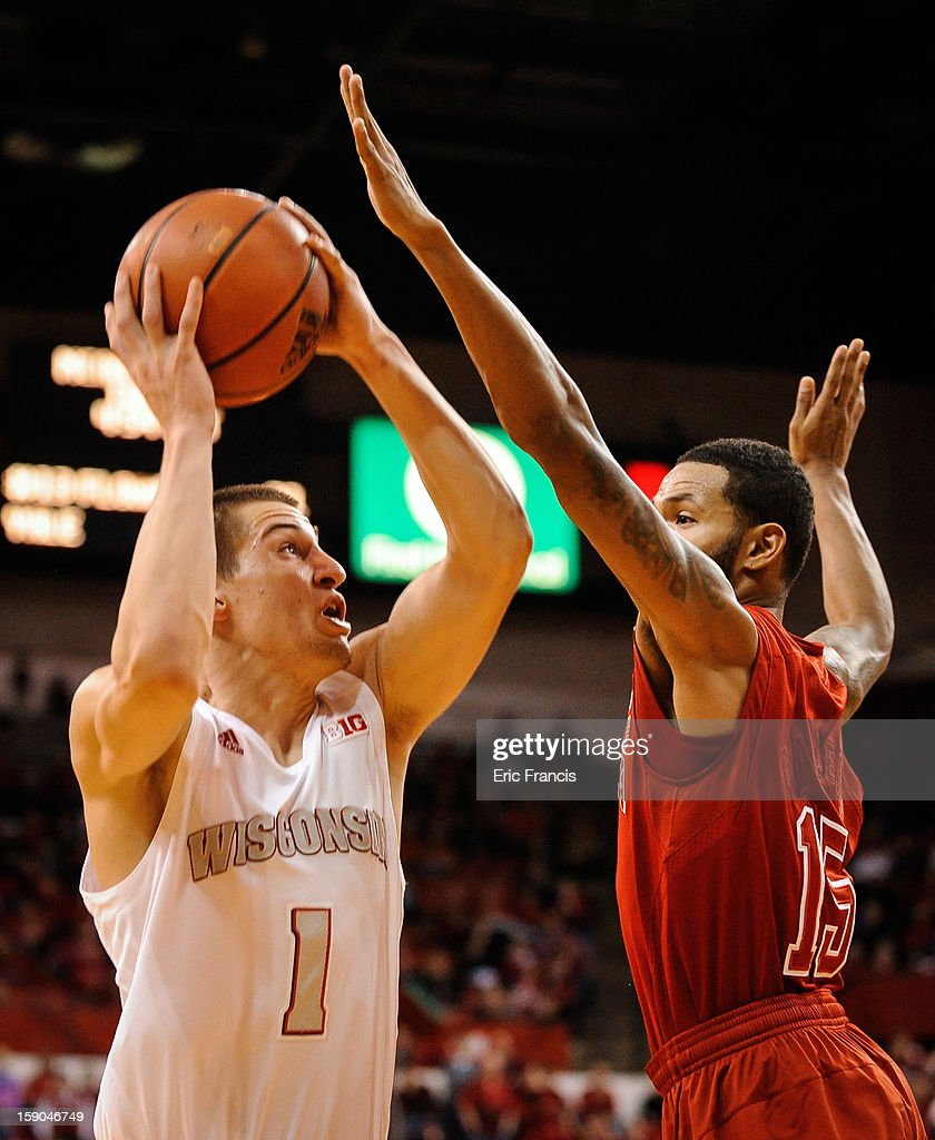 Ben Brust #1 of the Wisconsin Badgers shoots around Ray Gallegos #15 of the Nebraska Cornhuskers during their game at the Devaney Center on January 6, 2013 in Lincoln, Nebraska. Wisconsin defeated Nebraska 47-41.