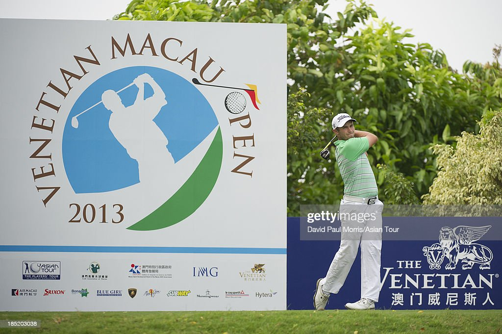 Ben Campbell of New Zealand hits his tee shot on the 1st hole during round two of the Venetian Macau Open on October 18, 2013 at the Macau Golf & Country Club in Macau. The Asian Tour tournament offers a record US$ 800,000 prize money which goes through October 20.