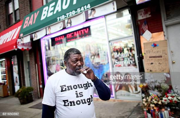 Ben Carr stepfather of Eric Garner smokes a cigarette near Garner's memorial in Staten Island NY on December 05 2014 Garner died in July after a...