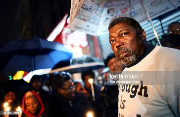 Ben Carr stepfather of Eric Garner speaks during a candlelight vigil near Garner's memorial in Staten Island NY on December 05 2014 Garner died in...