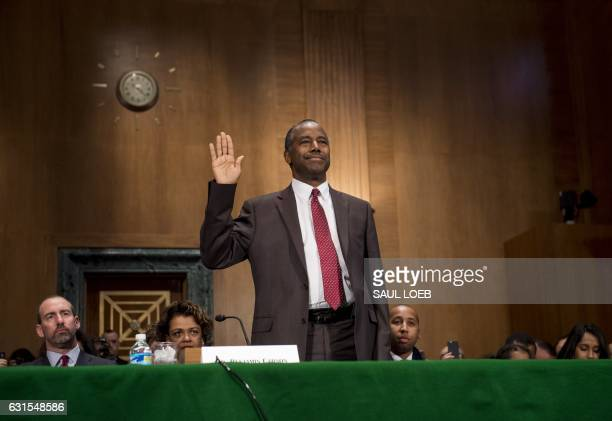 Ben Carson is swornin prior to testifying during his confirmation hearing for Secretary of Housing and Urban Development before the Senate Banking...