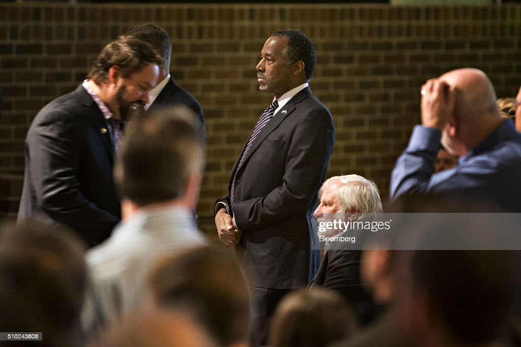 <a gi-track='captionPersonalityLinkClicked' href=/galleries/search?phrase=Ben+Carson&family=editorial&specificpeople=3233819 ng-click='$event.stopPropagation()'>Ben Carson</a>, retired neurosurgeon and 2016 Republican presidential candidate, center, stands as he arrives for a service at Morning Star Ministries in Fort Mill, South Carolina, U.S., on Sunday, Feb. 14, 2016. Carson, responding to a question on MSNBC about the upcoming primary, said he continues to reassess the future of his campaign every day and that South Carolina will be a 'turning point.' Photographer: Daniel Acker/Bloomberg via Getty Images