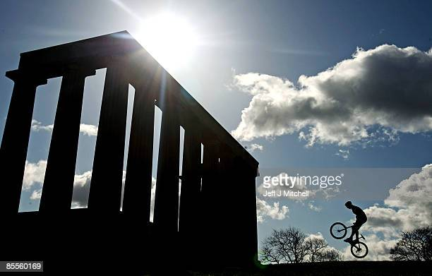 Ben Cathro performs on his mountain bike during the launch of the Nissan UCI Mountain Bike World Cup on Calton Hill on March 23 2009 in Edinburgh...