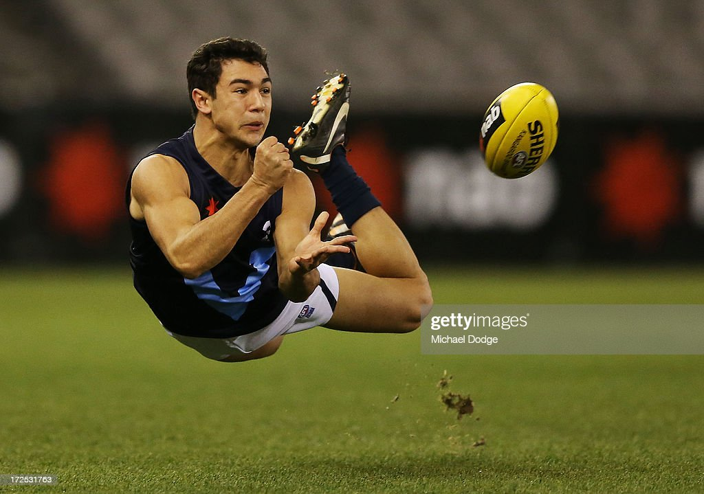 Ben Cavarra of Vic Metro handpasses the ball during the AFL Under 18s Championship match between Victoria Country and Victoria Metro at Etihad Stadium on July 3, 2013 in Melbourne, Australia.