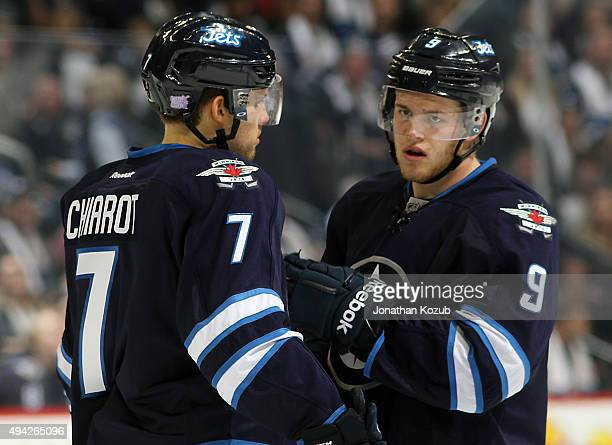 Ben Chairot and Andrew Copp of the Winnipeg Jets discuss strategy during a second period stoppage in play against the Minnesota Wild at the MTS...