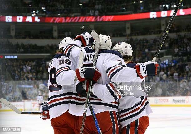 Ben Chiarot of the Winnipeg Jets celebrates his first period goal against the Minnesota Wild with teammates Patrik Laine and Bryan Little at the MTS...