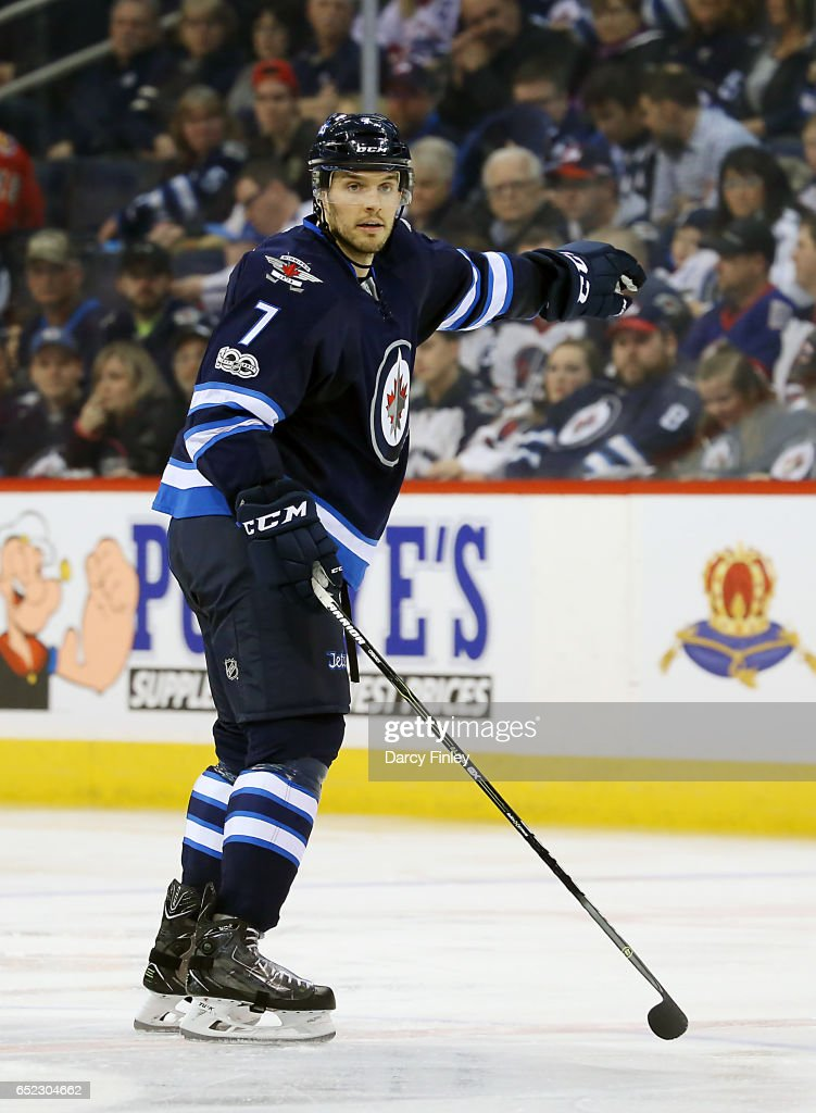 Ben Chiarot #7 of the Winnipeg Jets directs the play during third period action against the Calgary Flames at the MTS Centre on March 11, 2017 in Winnipeg, Manitoba, Canada.