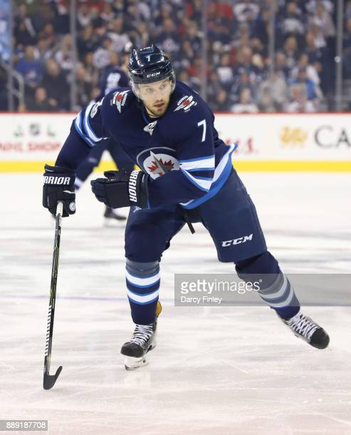 Ben Chiarot of the Winnipeg Jets follows the play down the ice during third period action against the Ottawa Senators at the Bell MTS Place on...