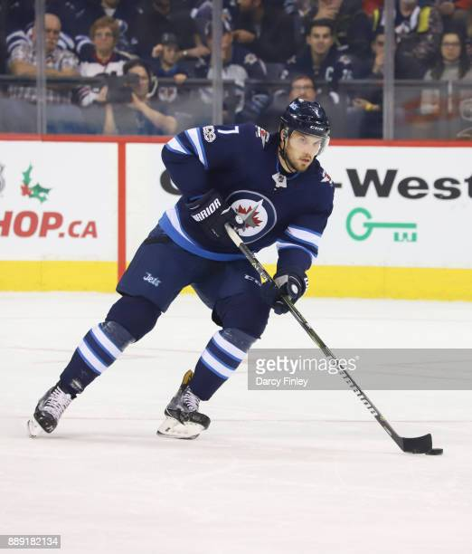 Ben Chiarot of the Winnipeg Jets plays the puck down the ice during first period action against the Ottawa Senators at the Bell MTS Place on December...