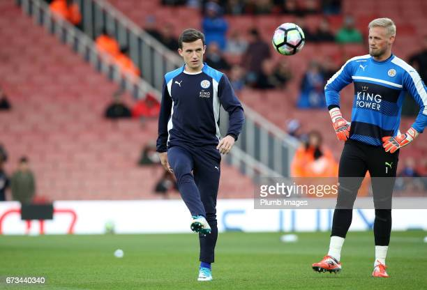 Ben Chilwell and Kasper Schmeichel of Leicester City warm up at The Emirates Stadium ahead of the Premier League match between Arsenal and Leicester...