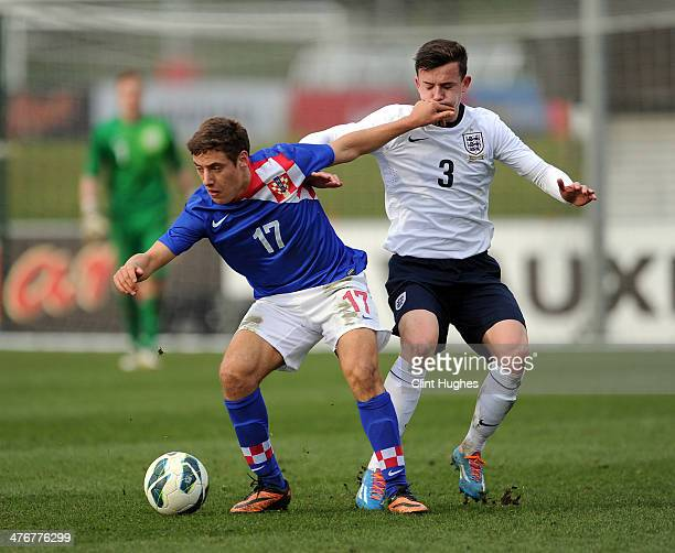 Ben Chilwell of England and Nikola Vlasic of Croatia battle for the ball during the U18 International friendly match between England and Croatia at...