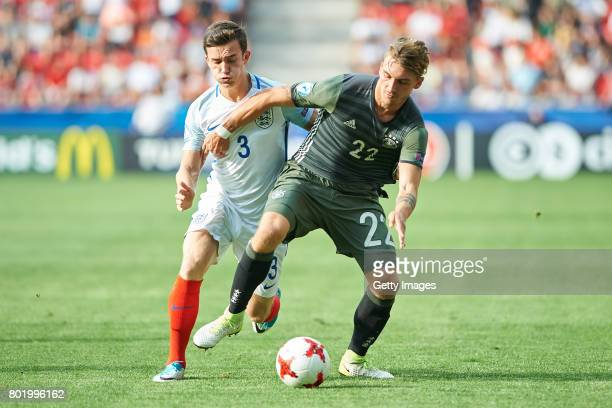 Ben Chilwell of England in action with Maximilian Philipp of Germany during the UEFA European Under21 Championship Semi Final match between England...