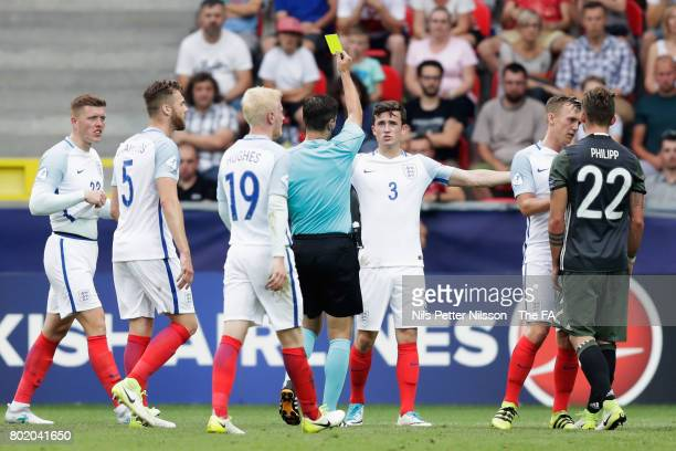 Ben Chilwell of England is shown a yellow card during the UEFA European Under21 Championship Semi Final match between England and Germany at Tychy...