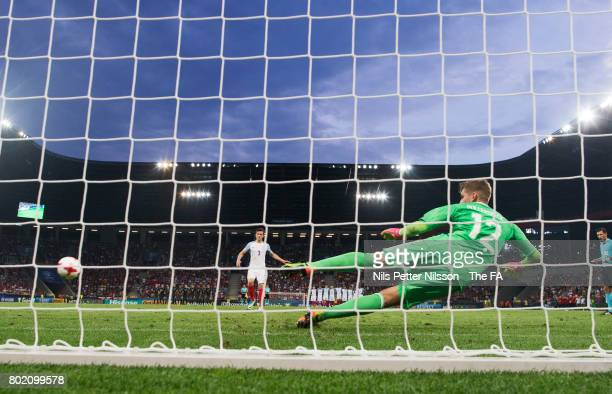 Ben Chilwell of England scores during the penalty shootout during the UEFA U21 semi final match between England and Germany at Tychy Stadium on June...