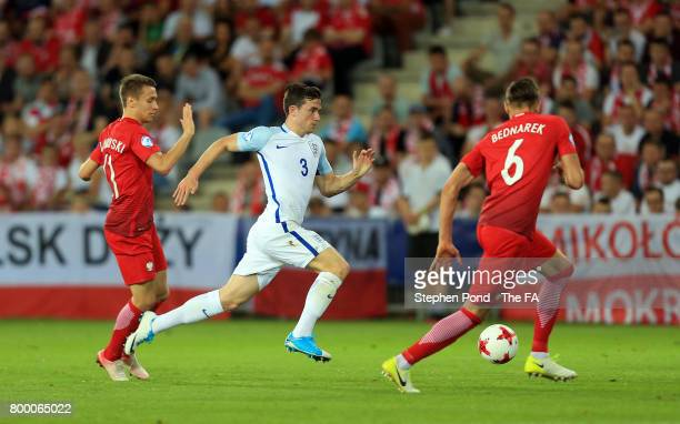 Ben Chilwell of England takes on Przemyslaw Frankowski and Jan Bednarek of Poland during the UEFA European Under21 Championship Group A match between...