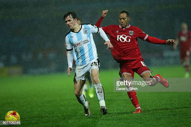 Ben Chilwell of Huddersfield Town FC is under pressure from Elliott Bennett of Bristol City FC during the Sky Bet Championship match between...