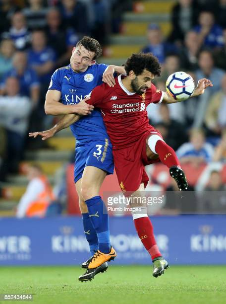 Ben Chilwell of Leicester City in action with Mohamed Salah of Liverpool during the Premier League match between Leicester City and Liverpool at The...