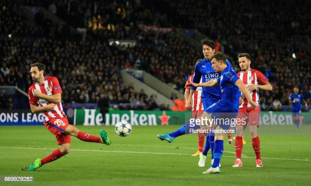 Ben Chilwell of Leicester City shoots while Juanfran of Atletico Madrid attempts to block during the UEFA Champions League Quarter Final second leg...