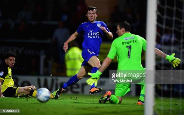 Ben Chilwell of Leicester City shoots wide of Stephen Bywater of Burton Albion during the PreSeason Friendly match between Burton Albion v Leicester...