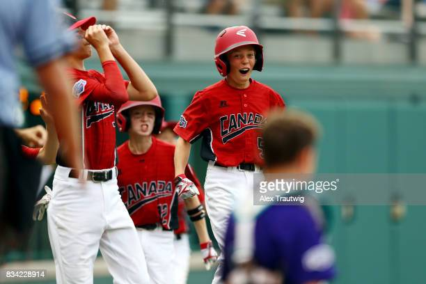 Ben Chowen of the Canada team from British Columbia reacts to a home run by Chase Marshall during Game 3 of the 2017 Little League World Series...