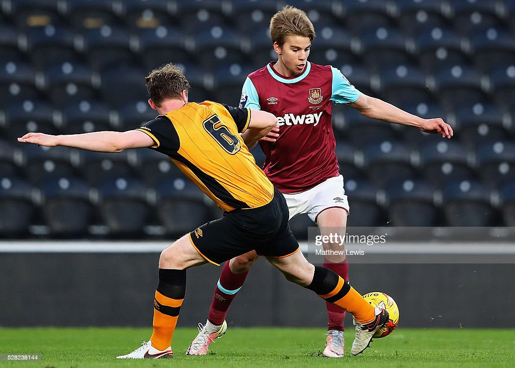 Ben Clappison of Hull tackles Martin Samuelsen of West Ham during the Second Leg of the Premier League U21 Cup Final at the KC Stadium on May 04, 2016 in Hull, England.