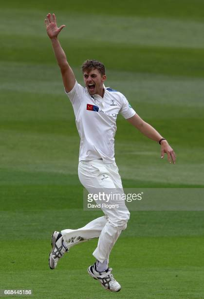 Ben Coad of Yorkshire celebrates after trapping Rikki Clarke LBW during the Specsavers County Championship One match between Warwickshire and...
