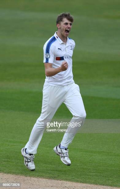 Ben Coad of Yorkshire celebrates dismissing Ian Bell of Warwickshire during day three of the Specsavers County Championship Division One match...