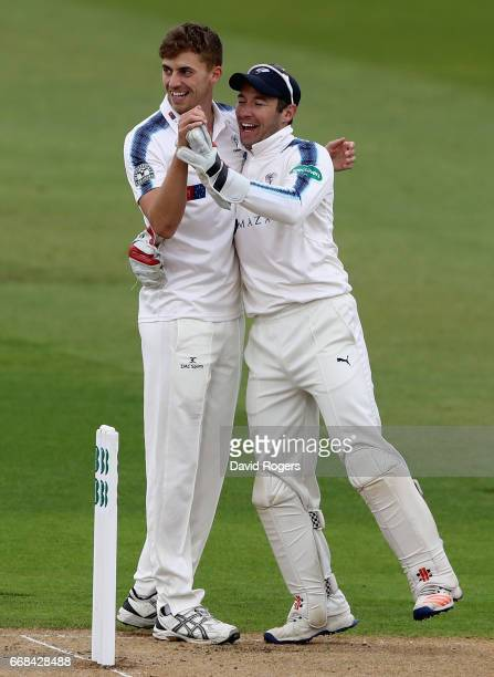 Ben Coad of Yorkshire celebrates with team mate Andrew Hodd after taking the wicket of William Porterfield during the Specsavers County Championship...