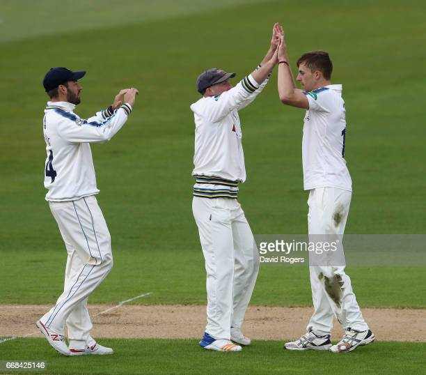 Ben Coad of Yorkshire celebrates with team mates after taking the wicket of Jonathan Trott during the Specsavers County Championship One match...