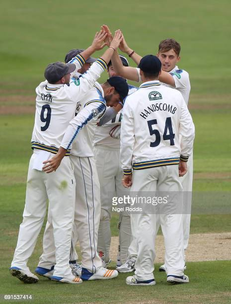Ben Coad of Yorkshire celebrates with teamates after taking the wicket of Steven Croft of Lancashire during Day One of the Specsavers County...