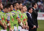 Ben Corporal Ben RobertsSmith VC and Raiders Coach Ricky Stuart stands along side Raiders players during the ANZAC service prior to the round eight...