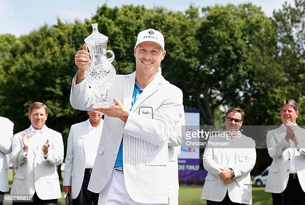 Ben Crane celebrates with the trophy after winning the FedEx St Jude Classic in the final round at the TPC Southwind on June 8 2014 in Memphis...