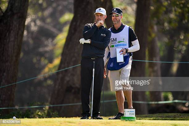 Ben Crane discusses his next shot with his caddy on the 15th hole during the second round of The RSM Classic at Sea Island Resort Plantation Course...