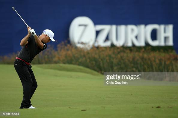 Ben Crane hits his third shot on the 18th hole during the continuaiton of the second round of the Zurich Classic of New Orleans at TPC Louisiana on...