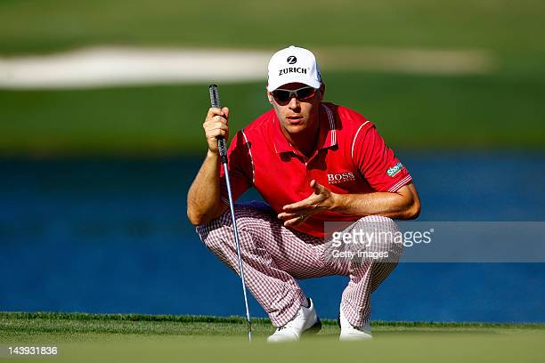 Ben Crane of the United States lines up a putt on the 17th green during the third round of the Wells Fargo Championship at the Quail Hollow Club on...