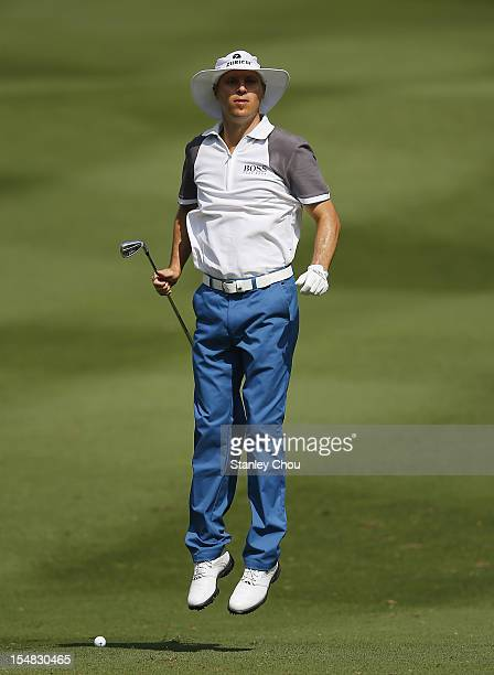 Ben Crane of USA jumps on the 1st hole during day three of the CIMB Classic at The MINES Resort Golf Club on October 27 2012 in Kuala Lumpur Malaysia