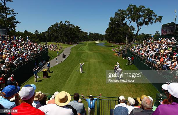 Ben Crane plays his tee shot on the first hole while Lucas Glover looks on during the final round of THE PLAYERS Championship held at THE PLAYERS...